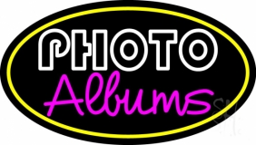 White Photo Album With Yellow Oval Neon Sign